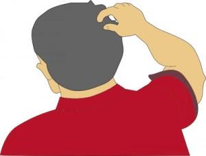 Kopf kratzen - manchmal die ersten Allergie Symptome